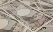 Bank Japonii drukuje, giełda szybuje, waluta dołuje