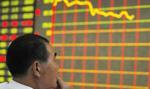 Silne spadki w Szanghaju z brokerami w rolach głównych